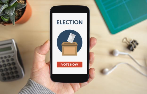 hand holding iphone with election ballot box